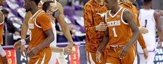 No. 15 Texas keeps road roll going with 76-64 win over TCU