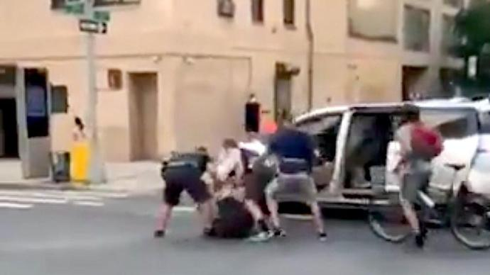 NYPD Under Scrutiny After Videos Show Officers Pulling Protester Into Unmarked Van