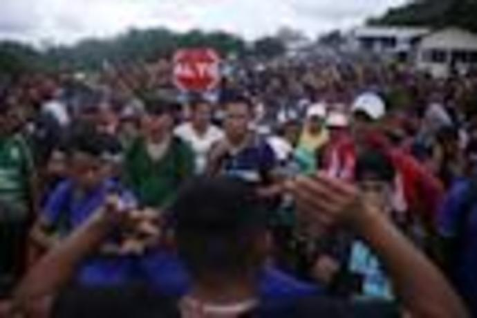 Migrants enter slowly at Guatemala-Mexico border after scuffles