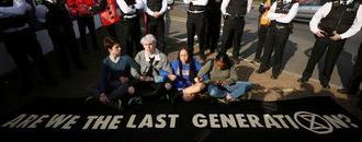 Weeping teenage climate activists in peaceful protest near London