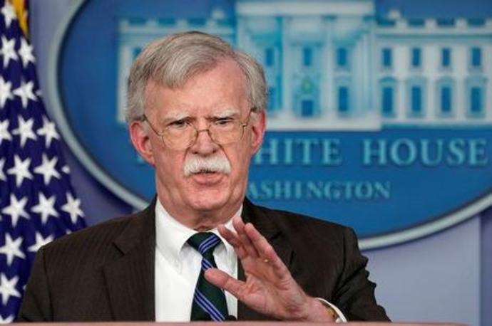 FILE PHOTO: Bolton speaks during a press briefing at the White House in Washington