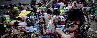 Thousands in U.S.-bound migrant caravan pour into Mexican city