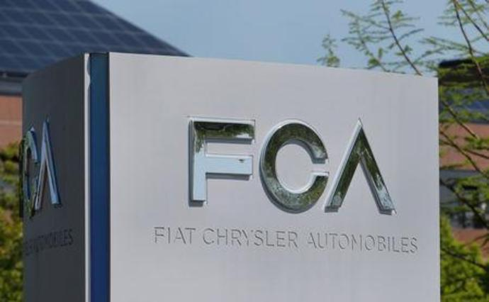 FILE PHOTO: A Fiat Chrysler Automobiles (FCA) sign is seen at its U.
