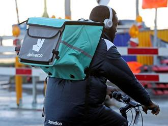 A courier for food delivery service Deliveroo rides a bike in central Brussels Reuters
