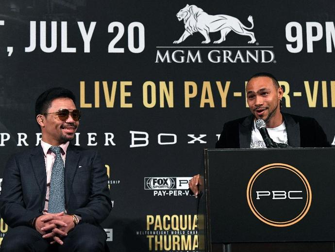 Keith Thurman speaks next to Manny Pacquiao during a press conference ahead of their WBA Welterweight Championship fight