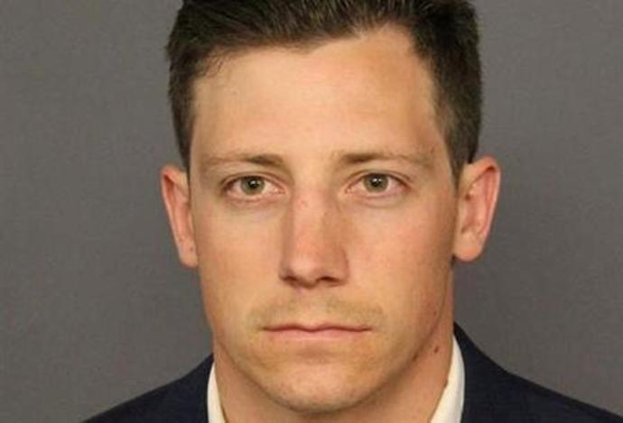 FBI agent Bishop appears in a booking photo in Denver