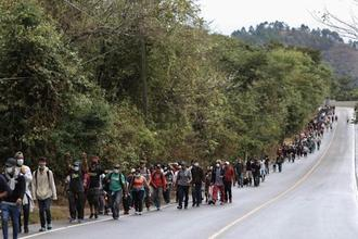 Migrants from Honduras hoping to reach the U.S. border walk along a highway Saturday in Guatemala. (Delmer Martinez / Associated Press)