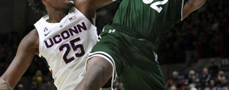 UConn wins defensive battle, 61-46 over Manhattan