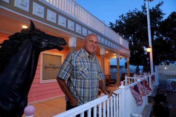 FILE PHOTO: Dennis Hof, owner of the Moonlite BunnyRanch legal brothel and recent winner of the Republican primary election for Nevada State Assembly District 36, poses outside the brothel in Mound House, Nevada