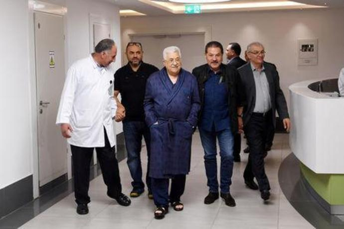 FILE PHOTO: Palestinian President Mahmoud Abbas walks inside the hospital in Ramallah, in the occupied West Bank