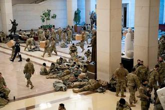 Members of the National Guard rest in the Visitor Center of the U.