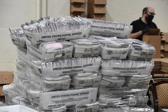 Mail-in ballots in their envelopes await processing at the Los Angeles County Registrar Recorders