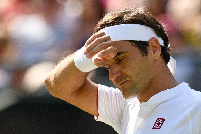 Roger Federer reacts during his stunning Wimbledon loss to Kevin Anderson