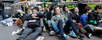 French climate activists in sit-in to denounce