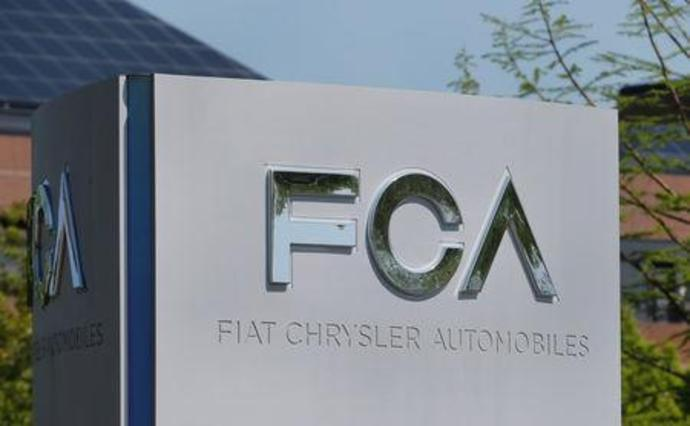 A Fiat Chrysler Automobiles (FCA) sign is seen at its U.