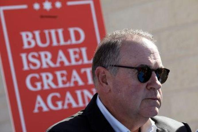 Former Arkansas Governor Huckabee attends a ceremony marking the construction of a new housing complex in the Israeli settlement of Efrat in the occupied West Bank