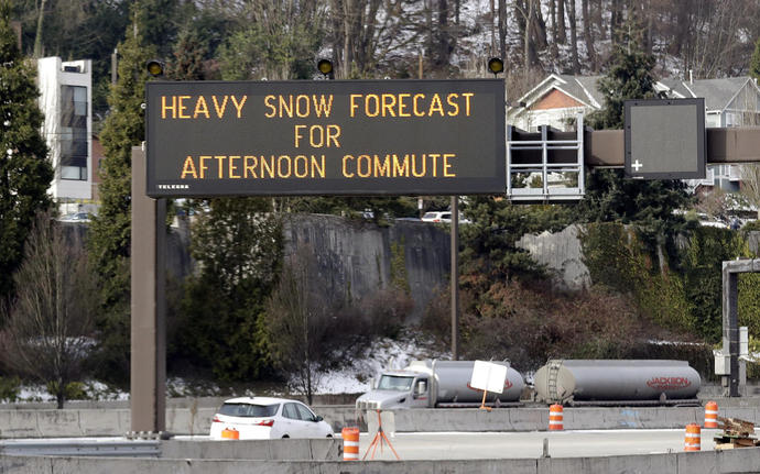 Snow storm wallops Seattle, people rescued in Sierra Nevada
