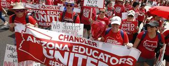Red-clad Arizona teachers march in 1st-ever statewide strike