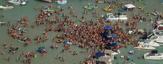 Huge sandbar party on Fourth of July may have spread COVID-19, Michigan officials say
