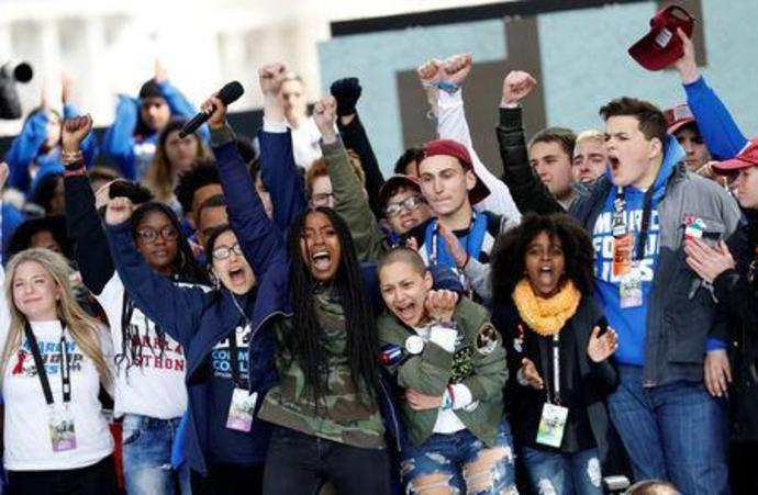 "FILE PHOTO: Students and young people gather for the ""March for Our Lives"" rally demanding gun control in Washington"