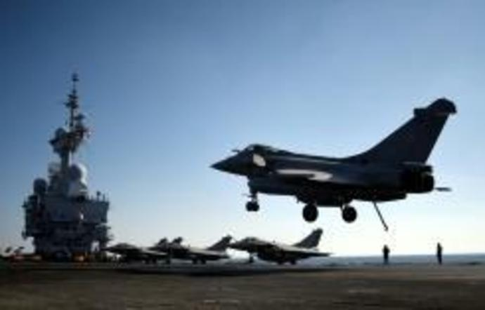 A French Rafale fighter jet lands on the deck of France