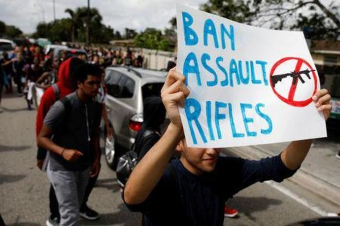 FILE PHOTO: Students from South Plantation High School carrying placards and shouting slogans walk on the street during a protest in support of the gun control, following a mass shooting at Marjory Stoneman Douglas High School, in Plantation