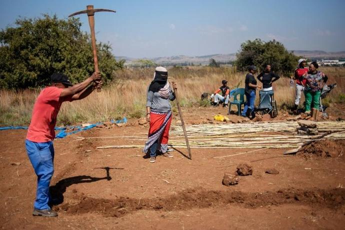 People take part in a land grabbing action near  Johannesburg as the government embraces enforced land reform as a flagship policy
