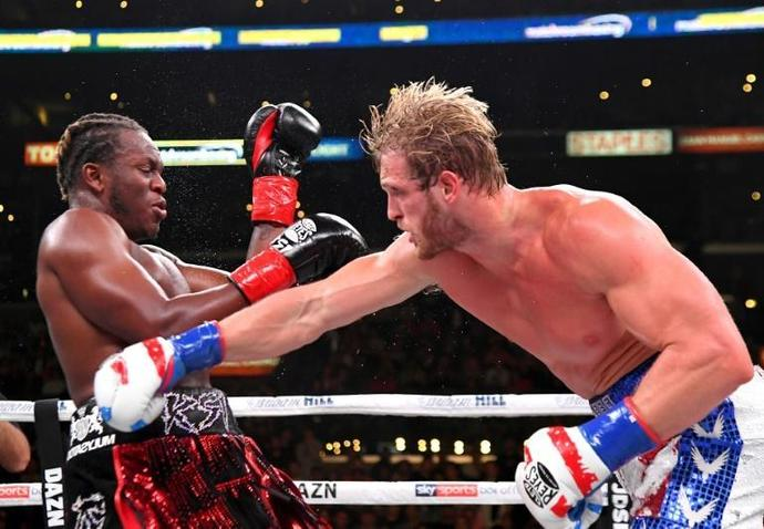 Logan Paul, right, delivers a punch to KSI in their cruiserweight fight Saturday at Los Angeles
