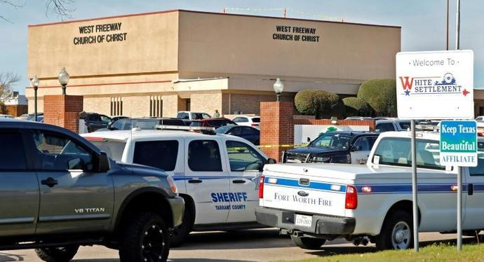 Law enforcement vehicles are parked outside West Freeway Church of Christ where a shooting took place at the morning service on December 29, 2019 in White Settlement, Texas