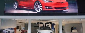 Tesla beats vehicle delivery estimates for second quarter, shares surge
