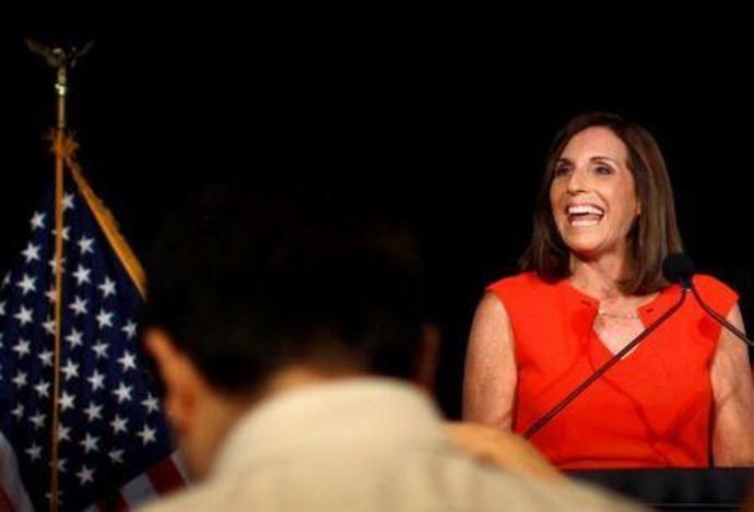 McSally greets her supporters on election night after winning the Republican primary for the open U.S. Senate seat in Tempe