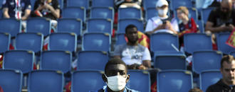 The Latest: Florida AD says he had a bout with coronavirus