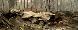 The Latest: Outbreak of norovirus at wildfire shelter
