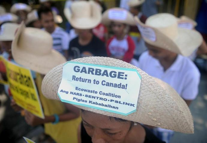 Environmental activists rallying outside the Philippine Senate in Manila in 2015 to demand that scores of containers filled with household rubbish be shipped back to Canada