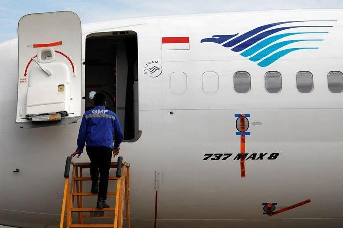 A technician prepares to check Garuda Indonesia