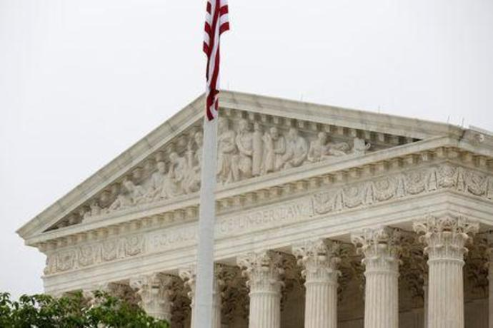The Supreme Court stands before decisions are released for the term in Washington