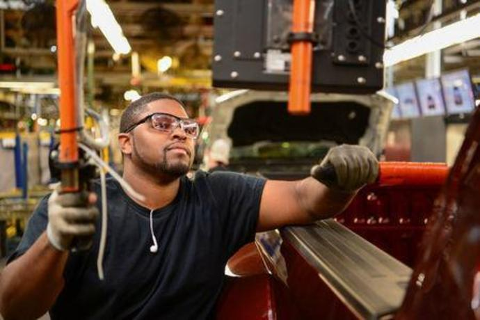 FILE PHOTO: A worker assembles a vehicle at a truck plant in Louisville, Kentucky