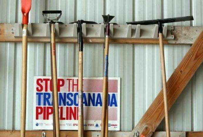 FILE PHOTO: Various anti-pipeline signs line the walls of the machine shed of Art and Helen Tanderup, who are against the proposed Keystone XL Pipeline that would cut through the farm where they live near Neligh, Nebraska