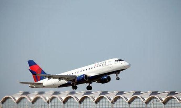 FILE PHOTO: A Delta Airlines jet takes off from Washington National Airport in Washington