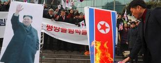North Korea says protesters who burned Kim Jong-un image are 'stinking conservative riff-raff'