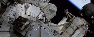 Spacewalking astronauts tackle more solar panel advance work