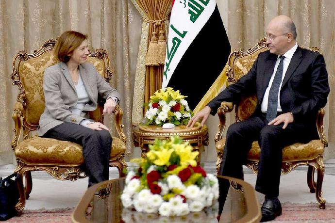 French Defence Minister Florence Parly (L) meets Iraqi President Barham Saleh (R) in Baghdad on February 8, 2019