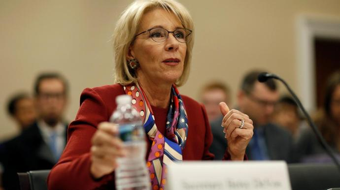 Questioned by a persistent lawmaker on Tuesday, Education Secretary Betsy