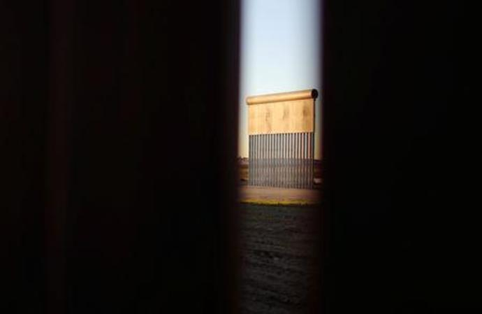 One of the prototypes of a border wall in Otay County, U.S., photographed through the border wall in Tijuana,