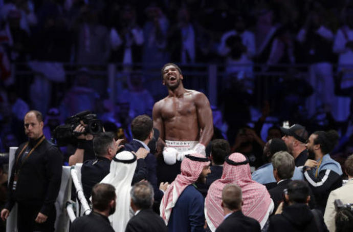 Joshua could fight without fans in first title defense