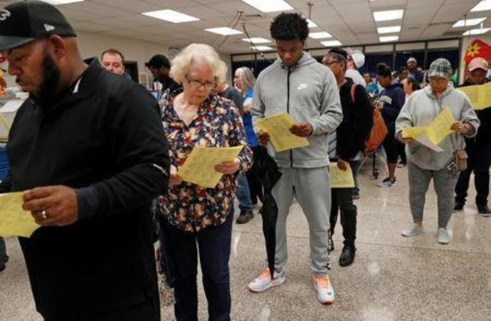 Georgians wait in line to cast their votes in U.S. midterm election in Georgia