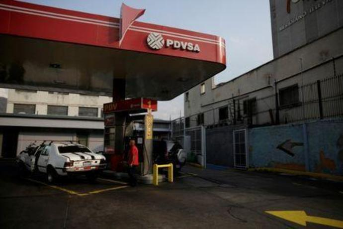 FILE PHOTO: The corporate logo of the state oil company PDVSA is seen at a gas station in Caracas