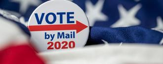 Voting by mail is popular in Florida, despite President Trump