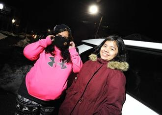Griselle Quinones, left, with her daughter Teresa Rosario, 9, outside their Ellis Street home, where there was a fire Friday, Feb.