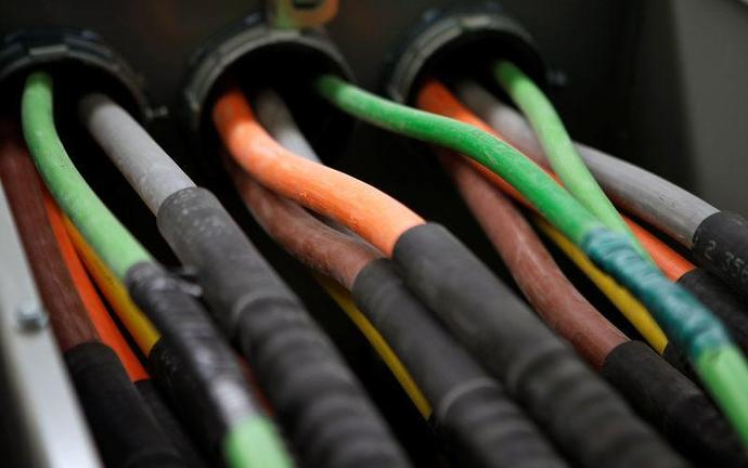 FILE PHOTO: Fiber optic cables carrying internet providers are seen running into a server room at Intergate.